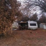 Woman arrested for reckless burning of RV trailer porch
